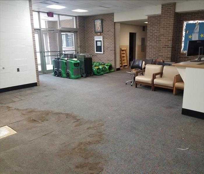 Front lobby of a university with severe water damage on the floors