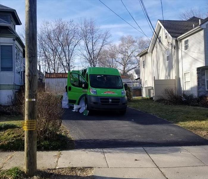 SERVPRO truck in the driveway of a home
