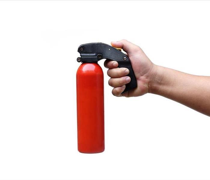 Hand hold a portable fire extinguisher